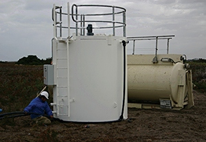 Vertical mixing tank at coal mine site for mixing and dosing reagents.
